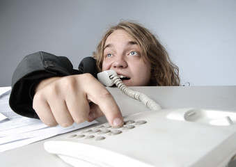 Crazy businessman dialing a phone number