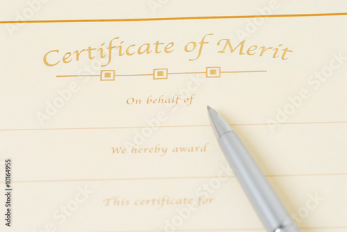 blank certificate and pen