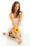 dreamy portrait of beautiful girl with yellow flower poster