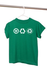 A green t-shirt on a hanger with recycle symbols