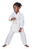 Fototapety Small karate girl training , isolated on white background