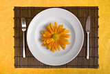 white dish with flower on bamboo board with yellow background poster