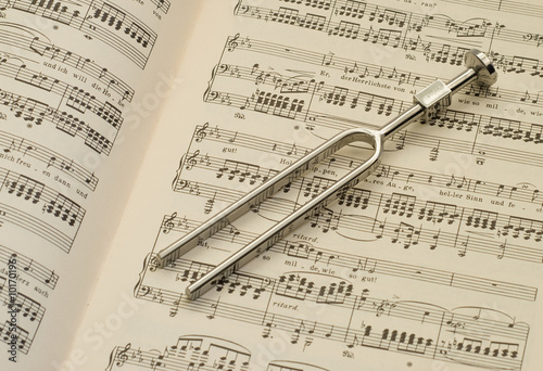 Tuning fork and sheet music