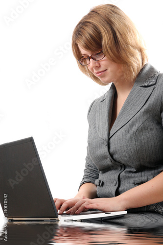 The Young businesslady with laptop.