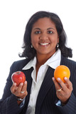 Woman comparing apples and oranges on a white background poster