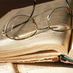 pages aging book and spectacles for correcting the vision