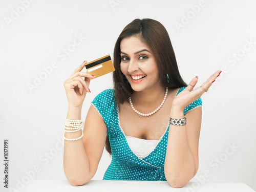 beautiful young asian female with her credit card