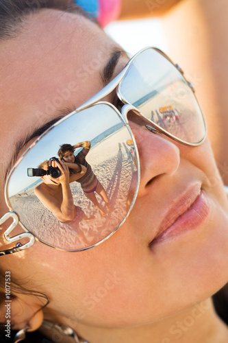 Reflexion of the photographer in model glasses