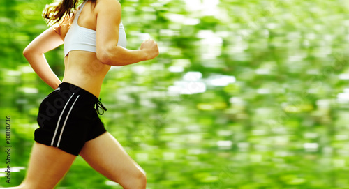 Fotobehang Persoonlijk Beautiful young woman runner in a green forest.