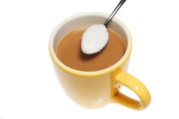 Mug of coffee and spoonful of sugar
