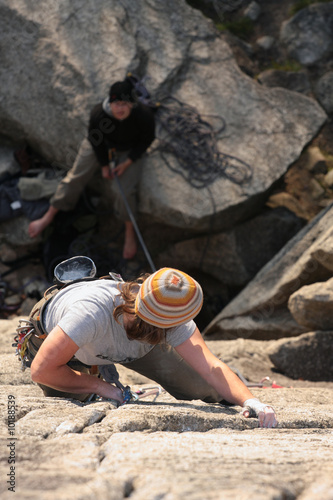 A female climber scales a popular climb in Squamish, BC, Canada.