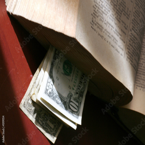 old paper bills and aging book