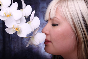 Beautiful young woman and white phalaenopsis orchid