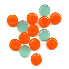 Pile of orange and green transparent tablets