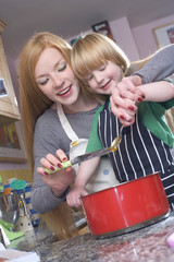 young family cooking in the kitchin