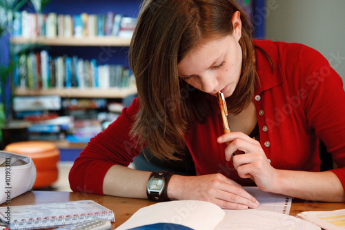 young female student doing her homework