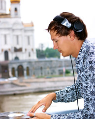 DJ Roman Kravtsov with his headphones playing outside