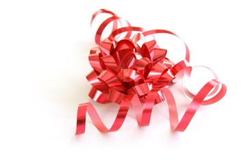 Red gift bow with matching red curled ribbon