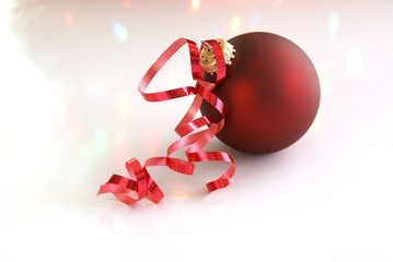 Red Christmas tree ball with curled red ribbon