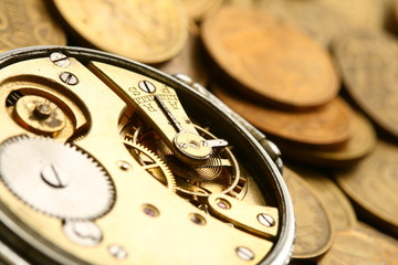 time is money coins and clock macro concet