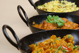 Lamb jalfrezi with vegetable curry and rice.