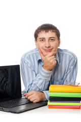 young adult man with books and laptop closeup vertical