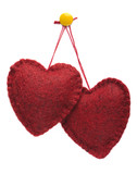 Two felt hearts hanging together on a yellow thumbtack poster