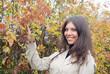 Beautiful romantic brunette with golden autumn