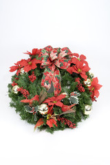 A wreath decorated with dried and silk flowers for Christmas.