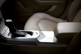 Gear stick and interior of a brand new modern car - shallow DoF poster