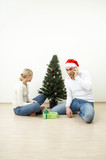 The pair decorates a Christmas pine in expectation of visitors poster