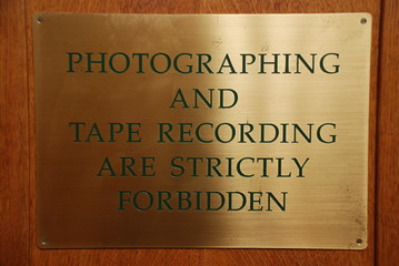"a sign saying ""photographing and tape recording forbidden"""