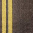 Double yellow line on asphalt texture