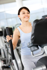 beautiful woman at the gym doing cardio exercise