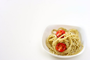 Plain pasta olio in small square shaped bowl