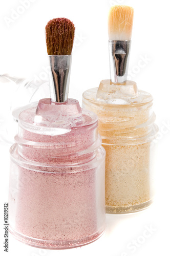 Light pink and gold make-up eye-shadows and brushes