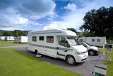 mobile home on a  caravan holiday site poster
