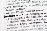 A close up of the word justice from a dictionary poster