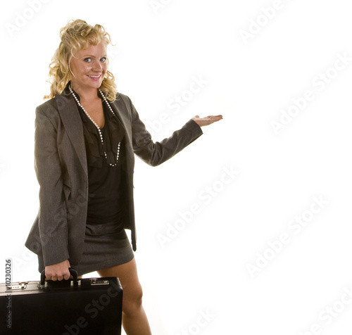 A blonde woman with a briefcase and holding her hand