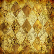 golden fabric with geometric ornament