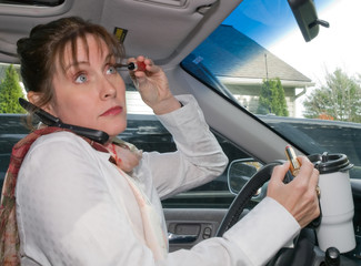 Woman Multi-Tasking While Driving