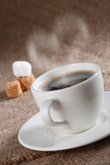 black coffee in white  cup with heart shape steam, shallow DOF