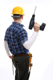 Construction worker holding an electric hand drill
