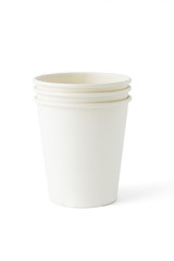 Stack of three disposable paper cups on white background
