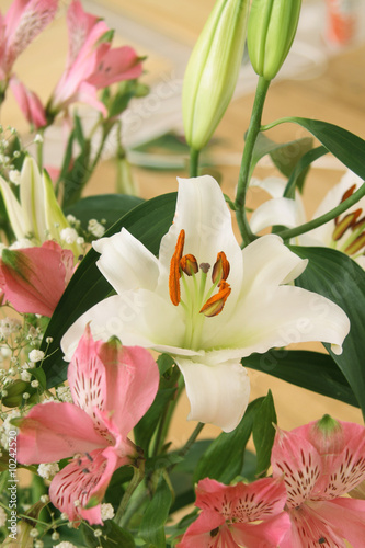 Bouquet from lilies of white and pink color.