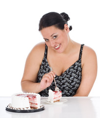 chubby girl sitting by the table with slice of cake
