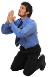 young Business man on his knees praying poster