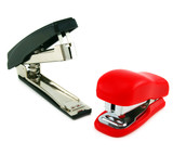 Two staplers isolated on a white background