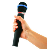 Wireless microphone in hand isolated on a white background