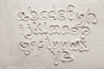 lower case alphabet written in sand - a designers tool